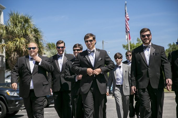 groom and groomsmen walking in this Crystal Coast Wedding | North Carolina wedding photographed by Ellen LeRoy Photography - https://emmalinebride.com/real-weddings/breathtaking-crystal-coast-wedding-mara-will-married/