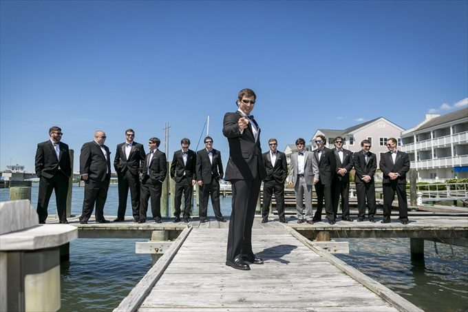 groom and groomsmen posed photo off the water in this Crystal Coast Wedding | North Carolina wedding photographed by Ellen LeRoy Photography - https://emmalinebride.com/real-weddings/breathtaking-crystal-coast-wedding-mara-will-married/