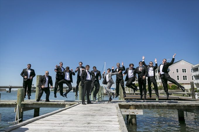 groom and groomsmen jump in this fun photograph in this Crystal Coast Wedding | North Carolina wedding photographed by Ellen LeRoy Photography - https://emmalinebride.com/real-weddings/breathtaking-crystal-coast-wedding-mara-will-married/