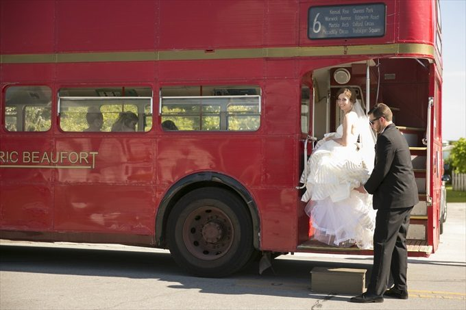 bride getting on bus in this Crystal Coast Wedding | North Carolina wedding photographed by Ellen LeRoy Photography - http://emmalinebride.com/real-weddings/breathtaking-crystal-coast-wedding-mara-will-married/