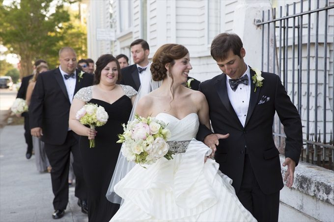 bride and groom walking out of church married in this Crystal Coast Wedding | North Carolina wedding photographed by Ellen LeRoy Photography - http://emmalinebride.com/real-weddings/breathtaking-crystal-coast-wedding-mara-will-married/