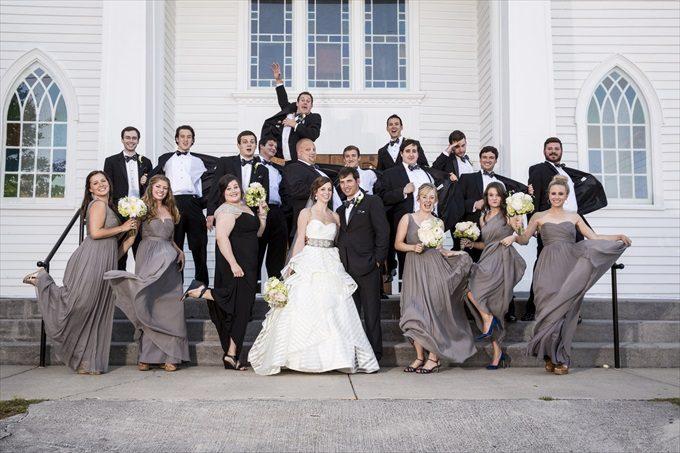 fun bridal party photograph in front of church in this Crystal Coast Wedding | North Carolina wedding photographed by Ellen LeRoy Photography - http://emmalinebride.com/real-weddings/breathtaking-crystal-coast-wedding-mara-will-married/
