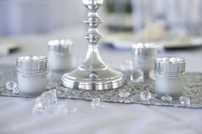 wedding reception table decorations in this Crystal Coast Wedding | North Carolina wedding photographed by Ellen LeRoy Photography - http://emmalinebride.com/real-weddings/breathtaking-crystal-coast-wedding-mara-will-married/