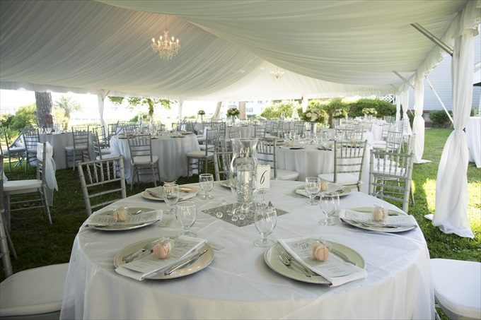 outdoor wedding reception tent in this Crystal Coast Wedding | North Carolina wedding photographed by Ellen LeRoy Photography - https://emmalinebride.com/real-weddings/breathtaking-crystal-coast-wedding-mara-will-married/