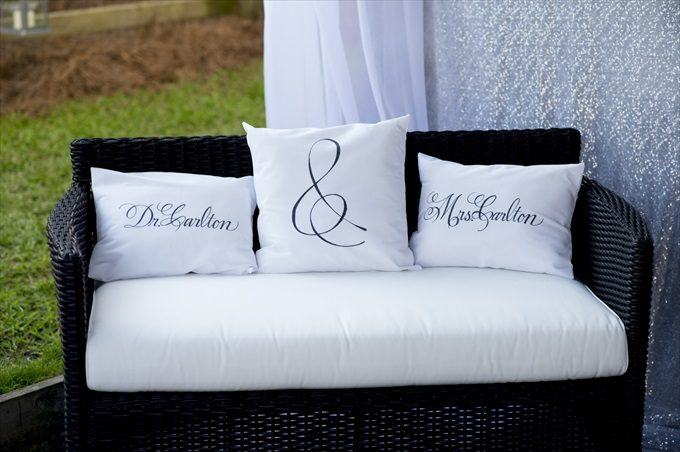 wedding pillows in this Crystal Coast Wedding | North Carolina wedding photographed by Ellen LeRoy Photography - https://emmalinebride.com/real-weddings/breathtaking-crystal-coast-wedding-mara-will-married/