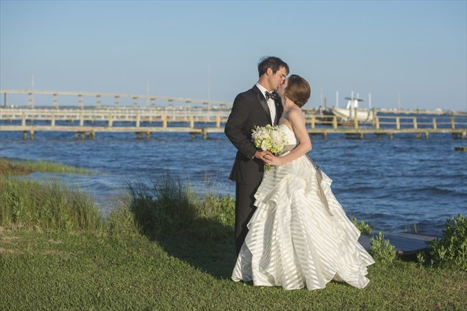 bride and groom kiss in this Crystal Coast Wedding | North Carolina wedding photographed by Ellen LeRoy Photography - http://emmalinebride.com/real-weddings/breathtaking-crystal-coast-wedding-mara-will-married/