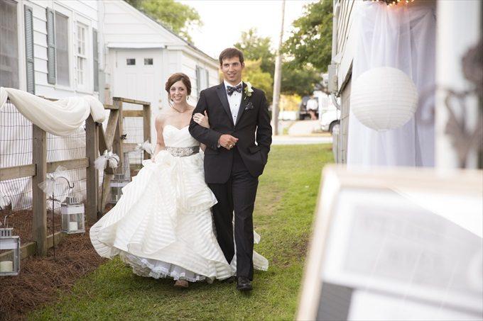 bride and groom enter reception in this Crystal Coast Wedding | North Carolina wedding photographed by Ellen LeRoy Photography - http://emmalinebride.com/real-weddings/breathtaking-crystal-coast-wedding-mara-will-married/
