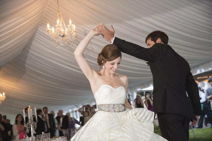groom twirls bride in this Crystal Coast Wedding | North Carolina wedding photographed by Ellen LeRoy Photography - http://emmalinebride.com/real-weddings/breathtaking-crystal-coast-wedding-mara-will-married/