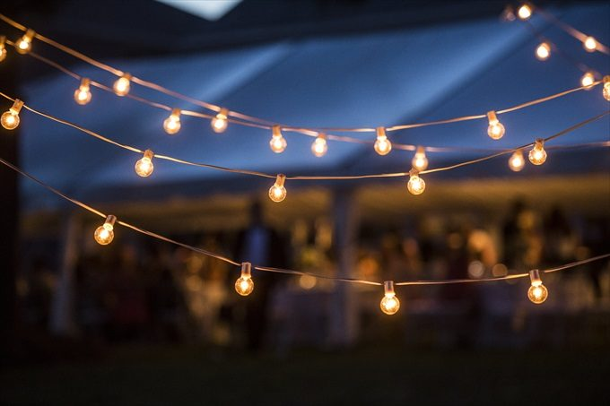 outdoor lighting at reception in this Crystal Coast Wedding | North Carolina wedding photographed by Ellen LeRoy Photography - https://emmalinebride.com/real-weddings/breathtaking-crystal-coast-wedding-mara-will-married/