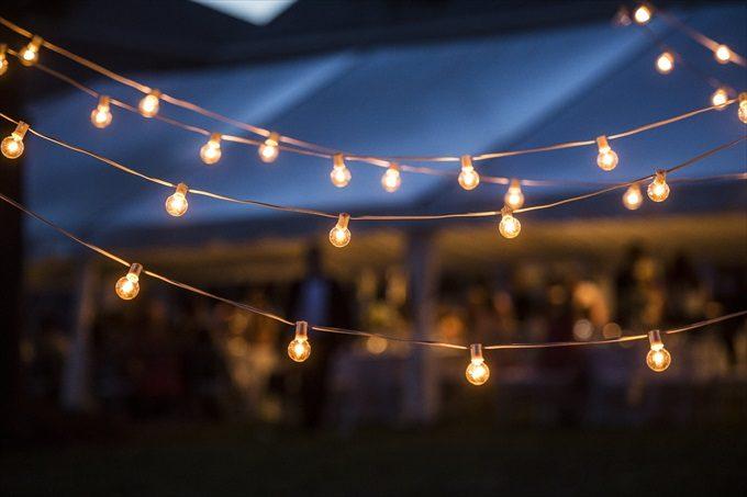 outdoor lighting at reception in this Crystal Coast Wedding | North Carolina wedding photographed by Ellen LeRoy Photography - http://emmalinebride.com/real-weddings/breathtaking-crystal-coast-wedding-mara-will-married/