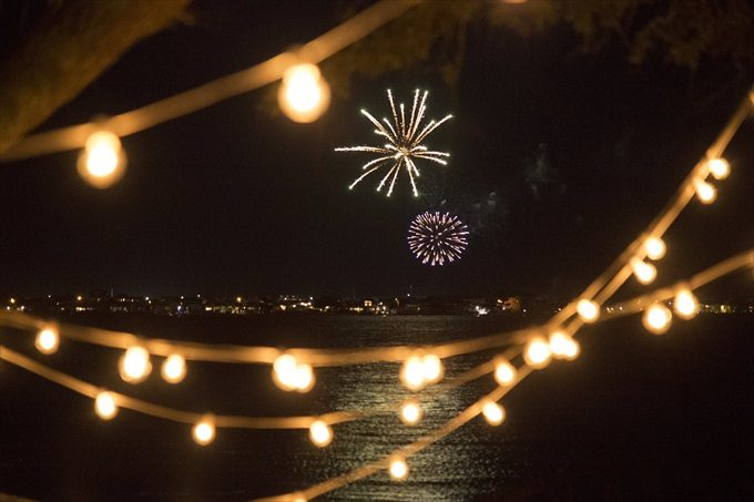 fireworks over the water in this Crystal Coast Wedding | North Carolina wedding photographed by Ellen LeRoy Photography - https://emmalinebride.com/real-weddings/breathtaking-crystal-coast-wedding-mara-will-married/