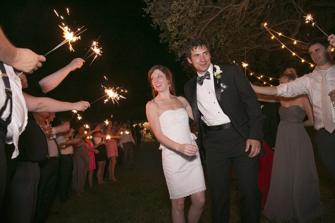 sparkler sendoff in this Crystal Coast Wedding | North Carolina wedding photographed by Ellen LeRoy Photography - http://emmalinebride.com/real-weddings/breathtaking-crystal-coast-wedding-mara-will-married/