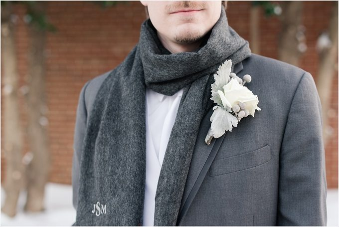 groom with custom scarf and white boutineer in this Sedgefield Country Club wedding| Greensboro, North Carolina winter wedding photographed by Michelle Robinson Photography - https://emmalinebride.com/real-weddings/sedgefield-country-club-wedding/