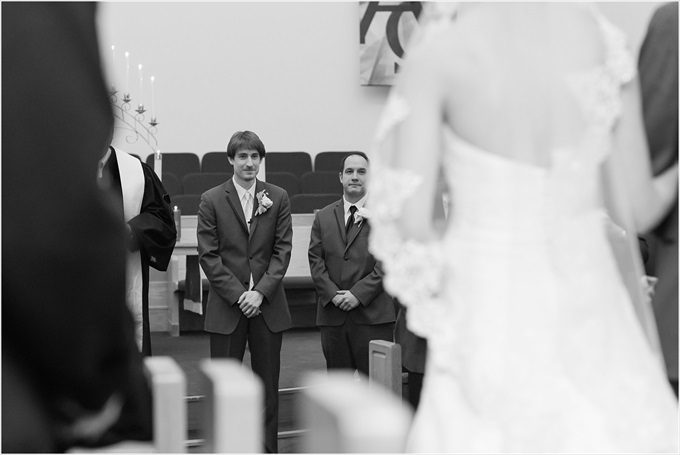 groom watches this bride walk down the aisle in this Sedgefield Country Club wedding| Greensboro, North Carolina winter wedding photographed by Michelle Robinson Photography - https://emmalinebride.com/real-weddings/sedgefield-country-club-wedding/