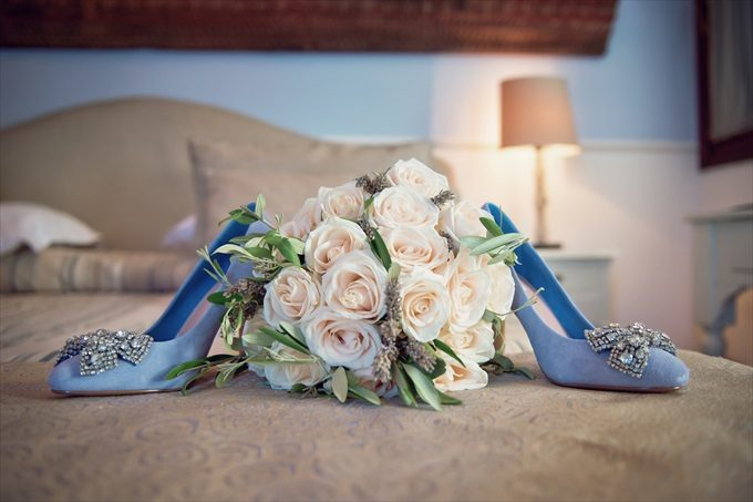 bride's blue wedding heels in destination wedding by Venice, Italy Wedding Planner - Venice Events| An Intimate + Beautiful Venice Wedding at Palazzo Cavalli - https://emmalinebride.com/real-weddings/beautiful-venice-wedding-at-palazzo-cavalli/