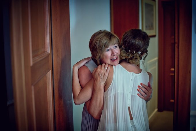bride hugs mother in destination wedding by Venice, Italy Wedding Planner - Venice Events| An Intimate + Beautiful Venice Wedding at Palazzo Cavalli - https://emmalinebride.com/real-weddings/beautiful-venice-wedding-at-palazzo-cavalli/