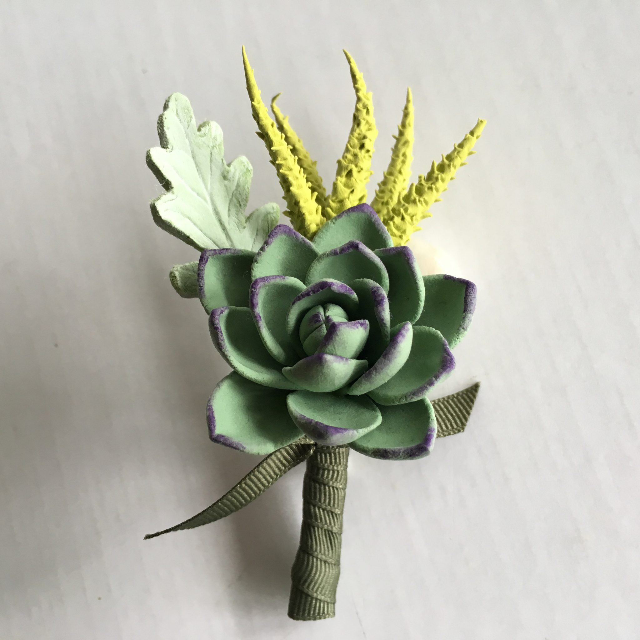 who gets wedding boutonnieres