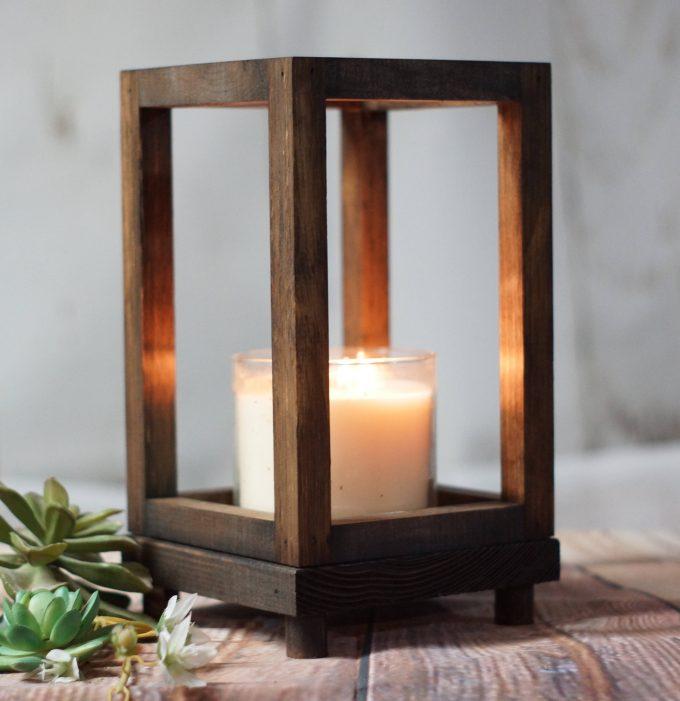 votive candle inside wood lantern