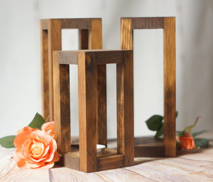 wood lanterns in a trio for centerpiece design