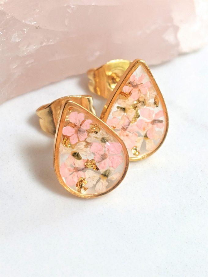 custom earrings made with preserved wedding flowers inside