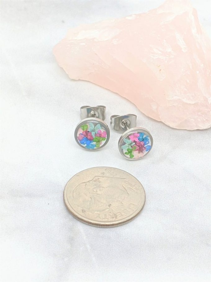 custom earrings made with preserved wedding flowers inside