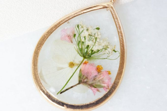 wedding flowers preserved as pressed necklaces