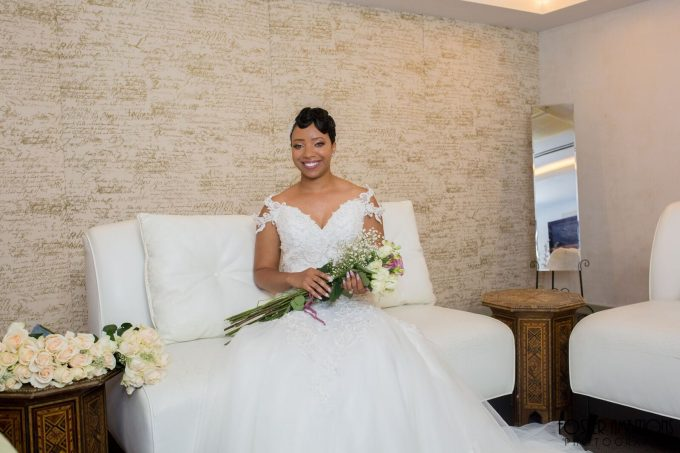 bride lounging with bouquet of roses - le club avenue wedding