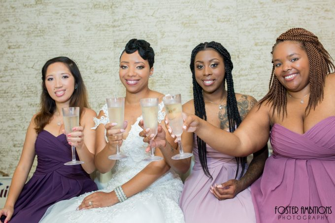 bride and bridesmaids toasting champagne - le club avenue wedding