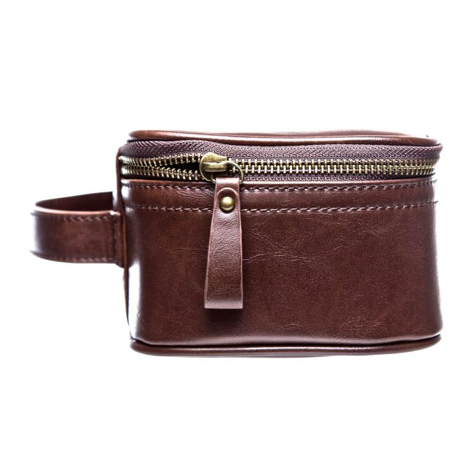 leather detail and hardware on mens toiletry bag