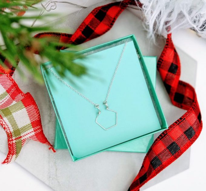 ring holder necklace with geometric design