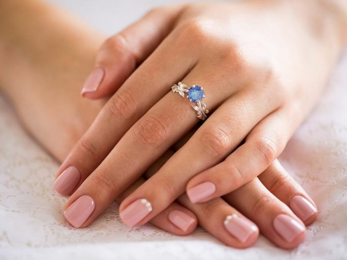 floral engagement ring with tanzanite stone