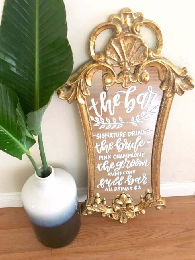 gold mirror bar sign