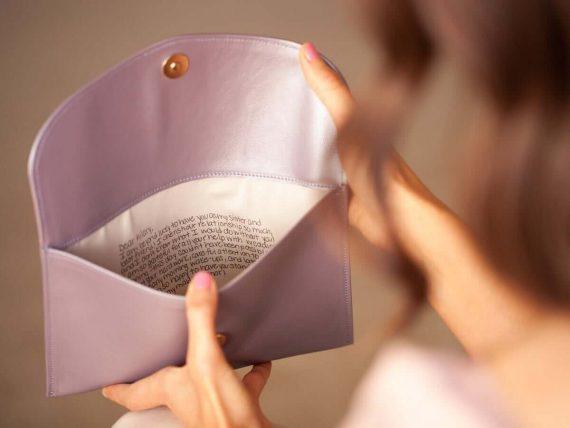 hidden message clutch purse