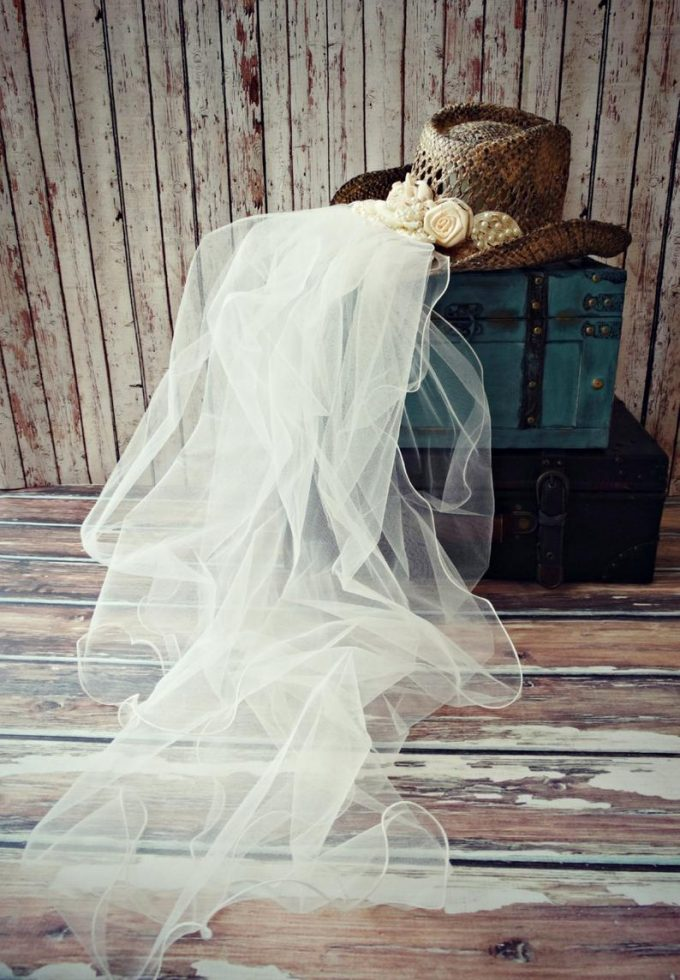 cowgirl hat for the bride with tule veil attached