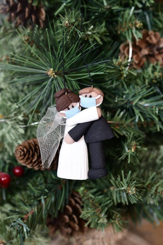 bride and groom with mask ornament