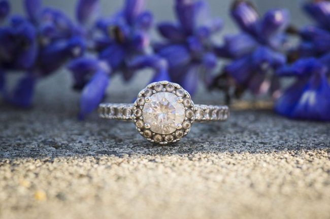 engagement ring with purple flowers in the background