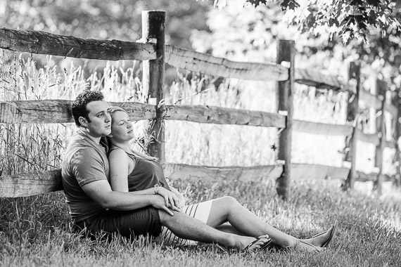 Annie & Josh's Engagement - couple laying in field