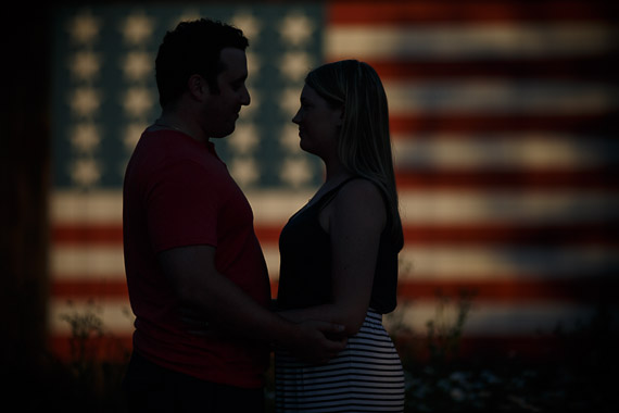 Annie & Josh's Engagement - engaged couple in front of American flag