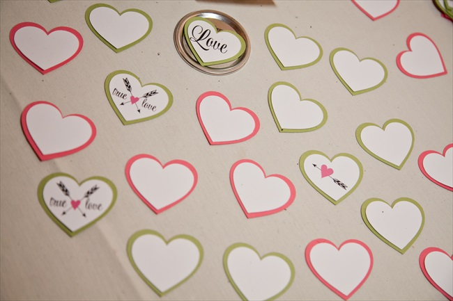 guests write on paper hearts their best wishes for bride and groom - Bodamaestra Maryland Handmade Wedding