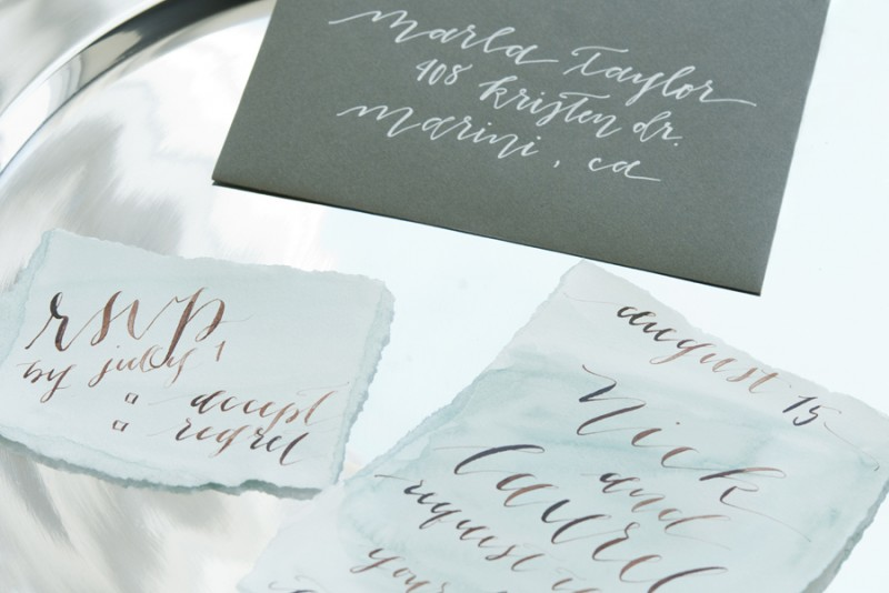 Calligraphy Invitations | photo: christine glebov | calligraphy: a quaint soiree | via A Dreamy Seaside Wedding Shoot at Glen Cove Marina https://emmalinebride.com/real-weddings/seaside-wedding-glen-cove-marina/