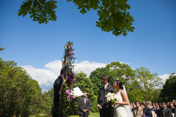 Daniel Fugaciu Photography - bride and groom under flowers arbor at tyler arboretum wedding