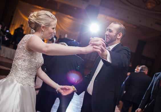 bride and groom dance at reception at Crystal Tea Room Wedding - photo: Daniel Fugaciu Photography | via https://emmalinebride.com