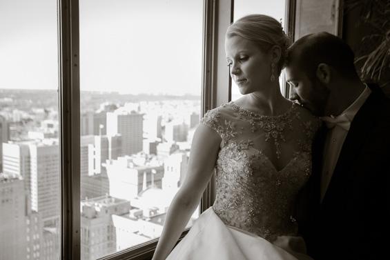 bride and groom overlooking Philadelphia - Crystal Tea Room Wedding - photo: Daniel Fugaciu Photography | via https://emmalinebride.com