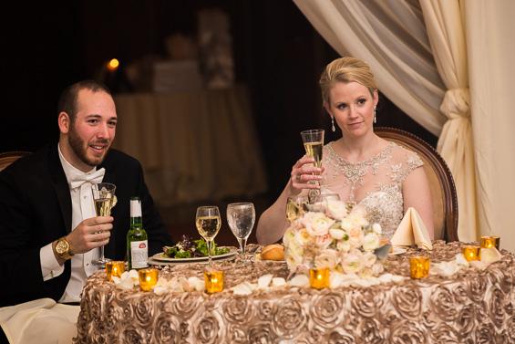 bride and groom listen to toasts at sweetheart table - photo: Daniel Fugaciu Photography | via https://emmalinebride.com