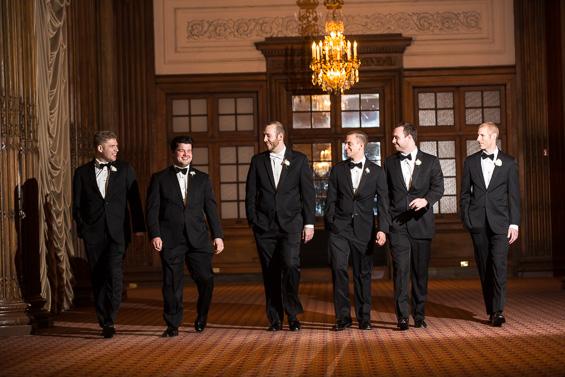 groom and groomsmen enter hotel - photo: Daniel Fugaciu Photography | via https://emmalinebride.com