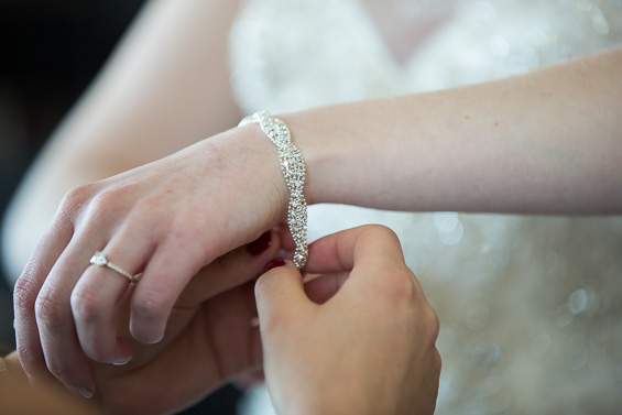 bride's wedding bracelet and ring - Crystal Tea Room Wedding - photo: Daniel Fugaciu Photography | via https://emmalinebride.com