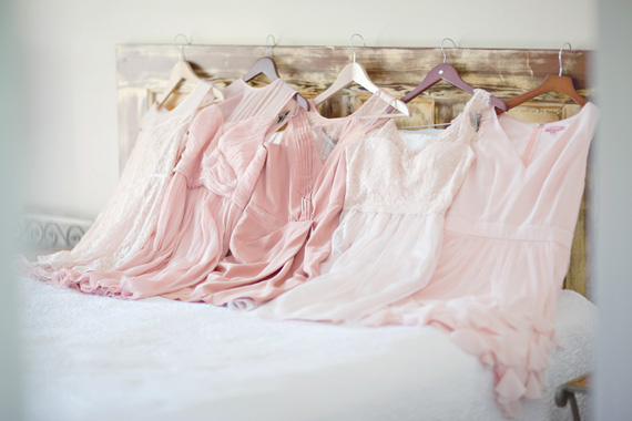 Kali Norton Photography - Mandeville Spring Wedding - bridesmaid dresses on the bed