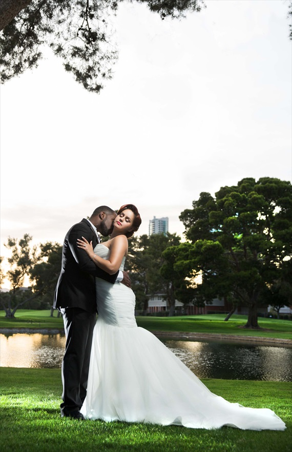 Imagine Studios - groom kissing bride at intimate las vegas wedding