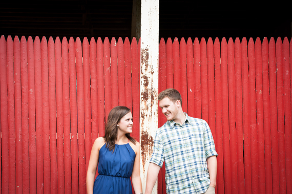 Scott Smith Photography - engaged couple standing by red picket fence
