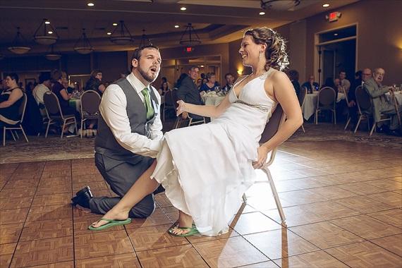 Matthew Steed Wilson Photography - groom looking for bride's garter